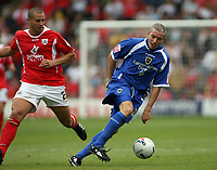 Photo: Rich Eaton.<br /> <br /> Barnsley v Cardiff City. Coca Cola Championship.<br /> <br /> 05/08/2006. Cardiffs Kevin McNaughton shield the ball from Cardiffs Marc Richards