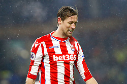 Stoke City's Peter Crouch leaves the pitch dejected after the final whistle of the Premier League match at Turf Moor, Burnley.