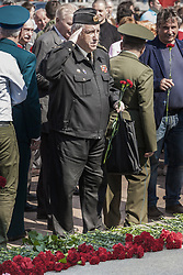May 5, 2018 - Moscow, Moscow, Russia - Man in militar uniform salutes under the memorial statue of Karl Marx during the celebrations of 200th anniversary of his birth in Moscow. (Credit Image: © Celestino Arce via ZUMA Wire)
