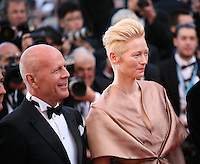 Actor Bruce Willis and Actress Tilda Swinton at the gala screening of the film Moonrise Kingdom at the 65th Cannes Film Festival. Wednesday 16th May 2012, the red carpet at Palais Des Festivals in Cannes, France.