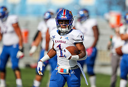 Oct 6, 2018; Morgantown, WV, USA; Kansas Jayhawks running back Pooka Williams Jr. (1) warms up prior to their game against the West Virginia Mountaineers at Mountaineer Field at Milan Puskar Stadium. Mandatory Credit: Ben Queen-USA TODAY Sports