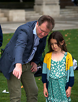 Richard Ratcliffe, Daughter Gabriella At the  photocall the  took place in Parliament Square to mark Nazanin Zaghari-Ratcliffe's 2000th day of being detained in Iran, A giant snakes and ladders board was used to show the ups and downs of Nazanin's case photo by Leigh Bruin