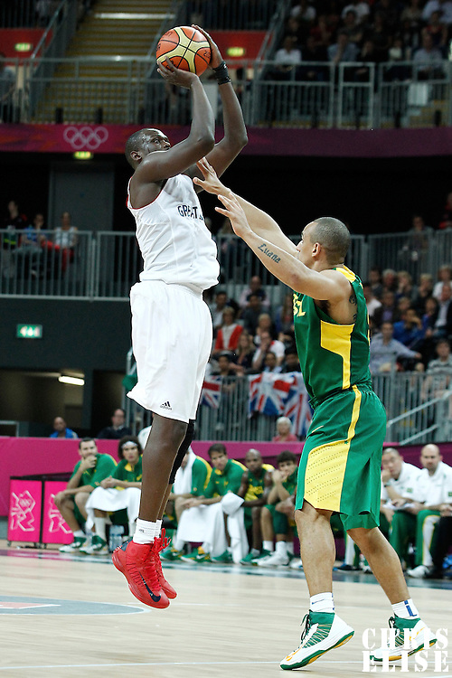 31 July 2012: Great Britain Luol Deng takes a jumpshot during 67-62 Team Brazil victory over Team Great Britain, during the men's basketball preliminary, at the Basketball Arena, in London, Great Britain.