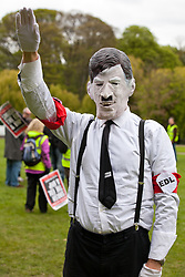 Luton, UK. 5th May, 2012. A man disguised as Adolf Hitler and wearing an EDL armband attends the We Are Luton/Stop The EDL rally, organised by We Are Luton and Unite Against Fascism in protest against a march by the far-right English Defence League.