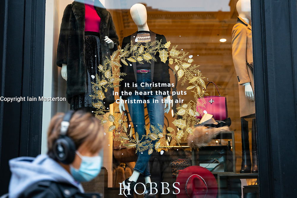 Edinburgh, Scotland, UK. 20 November 2020. Shop window displays with posters offering large discounted sale prices on Black Friday in Edinburgh. Pictured; Hobbs Christmas shop window display.  Iain Masterton/Alamy Live News