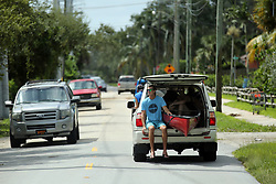 A man riding in an SUV holds a kayak in a vehicle in Fort Lauderdale on Monday, September 11, 2017, after Hurricane Irma blew through South Florida. Photo by Amy Beth Bennett/Sun Sentinel/TNS/ABACAPRESS.COM