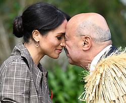 Meghan The Duchess of Sussex receives a hongi, a traditional Maori greeting, at an official welcome ceremony at Government House in Wellington, on the first day of the royal couple's tour of New Zealand. Photo credit should read: Doug Peters/EMPICS