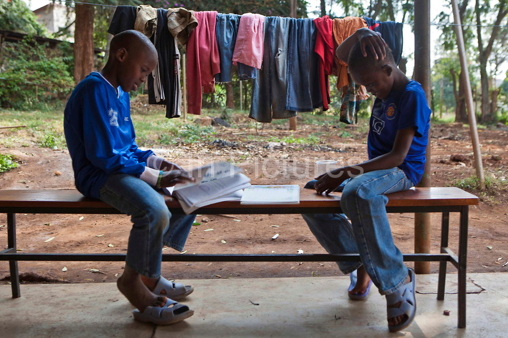A couple of young boys study at the AFCIC centre in Thika, Kenya. AFCIC - Action for children in conflict, help children who have been affected by various forms conflict or crisis.
