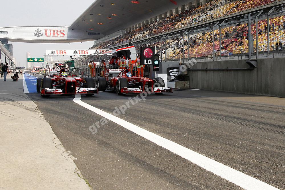 Felipe Massa (Ferrari) overtakes Fernando Alonso (Ferrari) at the pit exit. 2013 Chinese Grand Prix at Shanghai International Circuit, Shanghai. Photo: Grand Prix Photo