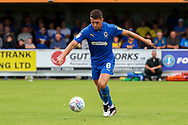 AFC Wimbledon midfielder Anthony Hartigan (8) passing the ball during the EFL Sky Bet League 1 match between AFC Wimbledon and Accrington Stanley at the Cherry Red Records Stadium, Kingston, England on 17 August 2019.