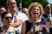 """Attendees sing the National Anthem during a """"Celebration of America"""" event on the South Lawn of the White House on June 5, 2018 in Washington, DC. The celebration is being staged as a replacement for a White House visit by the Super Bowl champion Philadelphia Eagles. Some of the team was planning on boycotting the event due to the President's stance on players kneeling during the National Anthem at NFL games, so Trump resented their invitation.      Photo by Pete Marovich/UPI"""