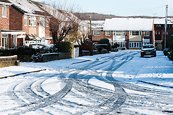 Tracks of commuters cars in the snow on Nursery Grove Ecclesfield North Sheffield .5 February 2013.Image © Paul David Drabble