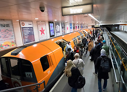 View of subway train and passengers at subway station platform on the Glasgow Subway system , Scotland, United Kingdom