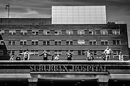 As military planes flyover to salute medical workers, staff of Suburban Hospital in Bethesda, Maryland stand on the roof in appreciation.