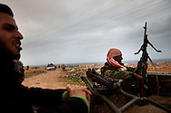 A rebel army volunteer preparse to fight forces loyal to Qadaffi in a town near Ras Lanuf  on March 3, 2011.