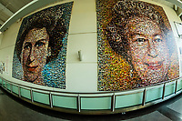 """On display at London Gatwick Airport is a BBC South East Jubilee Art Project titled """"The People's Monarch."""" It uses thousands of photos submitted by viewers that creates two large scale photo mosaics, by artist Helen Marshall. One portrait was taken around her coronation and the second is a more contemporary portrait of her."""