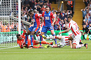 Wilfried Zaha of Crystal Palace attempts to score during a goalmouth scramble in the box as Goalkeeper Shay Given of Stoke City looks to block.. . Premier League match, Crystal Palace v Stoke city at Selhurst Park in London on Sunday 18th Sept 2016. pic by John Patrick Fletcher, Andrew Orchard sports photography.