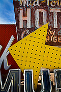 """The Neon Boneyard features more than 150 signs. For many years, the Young Electric Sign Company stored many of these old signs in their """"boneyard."""" The signs were slowly being destroyed by exposure to the elements. Private donations and loans have expanded the collection to the current size."""