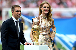 Former Germany captain Philipp Lahm and Natalia Vodianova pose with the world cup trophy prior to the FIFA World Cup Final at the Luzhniki Stadium, Moscow.