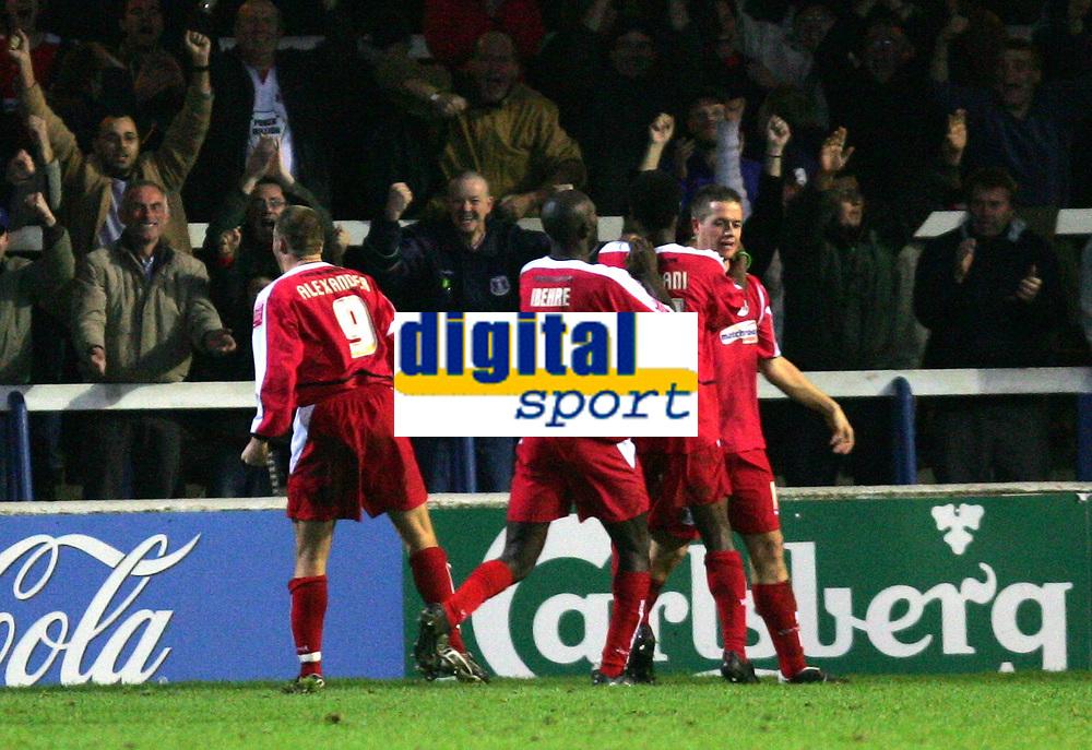 Photo: Frances Leader.<br />Peterborough Utd v Leyton Orient. Coca Cola League 2.<br />12/11/2005.<br />Orients Justin Miller (R), celebrates his goal past Borough's goalie Mark Tyler to equalise.