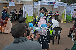 JOHANNESBURG, April 8, 2020  A nurse gives a mask to a citizen before the COVID-19 testing in Johannesburg, South Africa, April 8, 2020. The number of COVID-19 cases in South Africa has risen steadily over the past fews days amid massive community testing in a 21-day national lockdown. .   The country reported a total of 1,749 cases as of Tuesday, an increase of over 60 from Monday's announcement, Health Minister Zweli Mkhize said. (Photo by Shiraaz/Xinhua) (Credit Image: © Xinhua via ZUMA Wire)