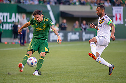 June 15, 2018 - Portland, Oregon, U.S. - PORTLAND, OR - JUNE 15: Portland Timbers defender Zarek Valentin takes a cross guarded LA Galaxy defender Ashley Cole during the Portland Timbers game versus the LA Galaxy in a United States Open Cup match on June 15, 2018, at Providence Park, OR. (Photo by Diego G Diaz/Icon Sportswire) (Credit Image: © Diego Diaz/Icon SMI via ZUMA Press)