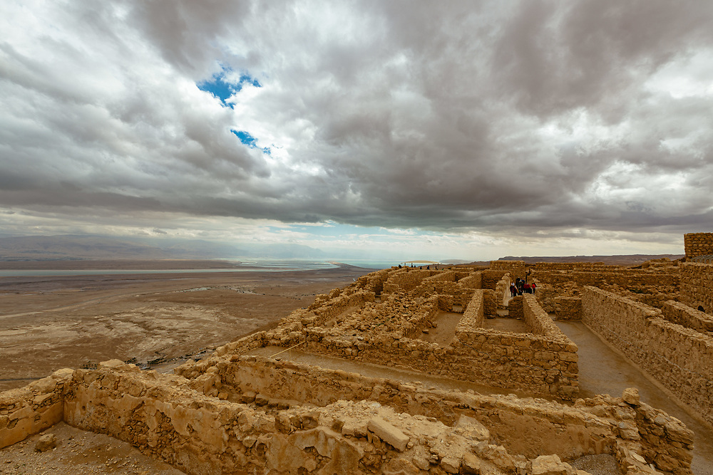 A general view of the Jordan Valley and the Dead Sea as seen from the ancient hilltop fortress of Masada in the Judean desert in Israel, on February 19, 2015. The ancient ruined desert fortress on a wind-swept plateau overlooking the Dead Sea is seen by many as an emblem of Israel's fighting spirit, it is believed to be the place where close to a thousand Jewish rebels killed themselves and each other about two millennia ago, rather than surrender and fall into slavery under the Romans.