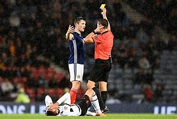 Scotland's John Soutattar (left) is shown a yellow card during the UEFA Nations League, League C Group one match at Hampden park, Glasgow.
