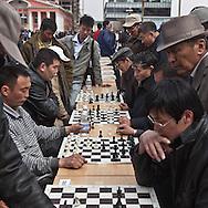 Mongolia. Ulaanbaatar. people playing chess on Sukhbaatar square, the city center of  Ulaanbaatar. ,  .