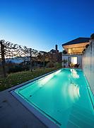 Beautiful modern house by night, swimming pool