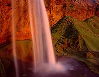 Seljalandfoss waterfall illuminated in the midnight sun, south Iceland, Europe