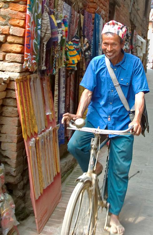 Biker in the alley, Kathmandu, Nepal