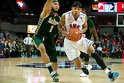 DALLAS, TX - JANUARY 15: Keith Frazier #4 of the SMU Mustangs drives past Musa Abdul-Aleem #1 of the South Florida Bulls on January 15, 2014 at Moody Coliseum in Dallas, Texas.  (Photo by Cooper Neill/Getty Images) *** Local Caption *** Keith Frazier