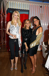 Left to right, model CLAUDIA SCHIFFER, designer TORY BURCH and ELIZABETH SALTZMAN at a party hosted by Elizabeth Saltzman and Harvey Nichols to celebrate the UK launch of New York fashion designer Tory Burch held at the Fifth Floor Restaurant, Harvey Nichols, Knightsbridge, London on 24th May 2006.<br />
