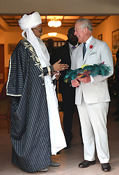 The Prince of Wales receives a feather fan as a gift during a meeting with Traditional Leaders at the High Commissioner's Residence in Nigeria, on day seven of his trip to west Africa with the Duchess of Cornwall.
