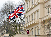 © Licensed to London News Pictures. 28/03/2013. CITY/TOWN e.g Windsor, UK A woman hoists the artwork. Installed on the roof of the Institute of Contemporary Arts (ICA)'s Regency building from 15 March 2013, Flag (Union Jack) by New York-based contemporary artist Frank Benson reflects the artist's ongoing fascination with the depiction of arrested motion and the use of digital tools in the creation of sculpture.. Photo credit : Stephen Simpson/LNP