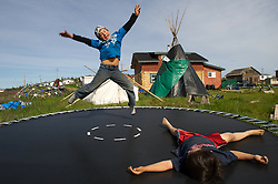 River Marlow, 7, and Levi Shearling, 6, play on their trampoline in their village of Lutsel Ke' (aka Snowdrift) July 21, 2011 in the Northwest Territories of Canada. This huge reach of untrammeled country, this abundant wildlife, is partially the result of the creation of the Thelon Wildlife Sanctuary. Located equidistant from Hudson Bay and Great Slave Lake, the region now encompassed by the sanctuary was never permanently settled. There are few places left on the planet as untouched as this.
