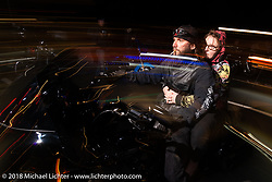 Riding at night on Lakeside Avenue in Weirs Beach during Laconia Motorcycle Week. NH, USA. Friday, June 15, 2018. Photography ©2018 Michael Lichter.