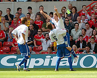Photo: Leigh Quinnell.<br /> Nottingham Forest v Brighton & Hove Albion. Coca Cola League 1. 19/08/2006. Brighton goalscorer Jake Robinson is given a lift by Alex Revell.