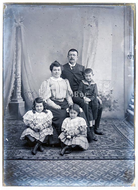 family group posing in a natural light indoors studio France circa 1920s
