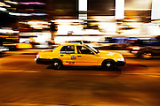 New York City, Speeding yellow taxi cab with motion blur