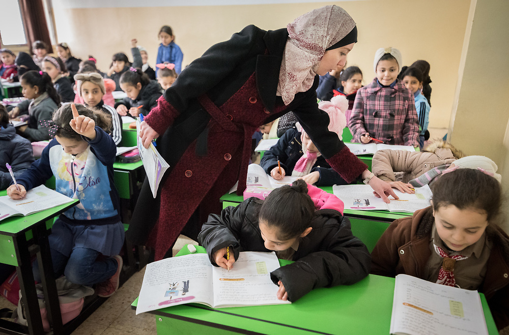 19 February 2020, Amman, Jordan: 10-year-old Bayan (bottom centre), a girl born with Cerebral Palsy, attends class at the Al Yarmouk Primary Mixed School, in the Lewa'a Al Jama'a district.  Following three years in a school exclusively for children with disabilities, today she attends 4th grade at Al Yarmouk, which has recently opened up to receive her. The school teaches some 750 students from 1st - 6th grade, most of them Jordanian, but some also from Syria and other countries. The school has received support from the Lutheran World Federation in refurbishing their buildings and classrooms, as well as training on protection and social cohesion, including how to become more inclusive of children with disabilities.