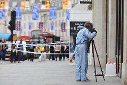© Licensed to London News Pictures. 05/06/2018. London, UK. Forensics police officers outside Watches of Switzerland on Regent Street after it was attacked by a gang on mopeds. It is being reported that the attackers were armed with knives. Photo credit: Rob Pinney/LNP