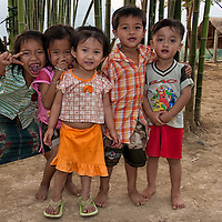 Children having fun while posing for the camera in Vang Vieng.