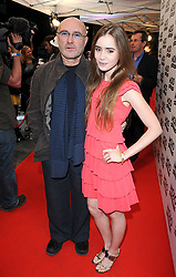 Phil Collins (left) and daughter Lily arrive for the Mojo Honours List award ceremony at The Brewery, east London.