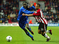 Photograph: Scott Heavey.<br />Southampton v Chelsea. FA Barclaycard Premiership. 22/11/2003.<br />Mario Melchiot (L) battles with Fabrice Fernandes