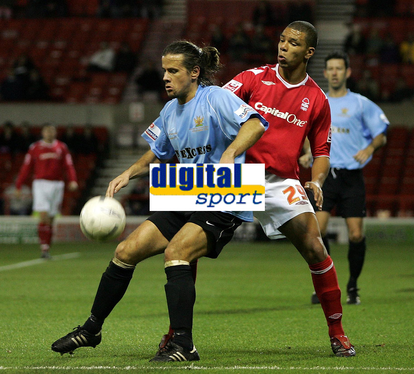 Photo: Paul Thomas.<br /> Nottingham Forest v Salisbury. The FA Cup. 12/12/2006.<br /> <br /> Paul Sales (L) of Salisbury backs into Julian Bennett.