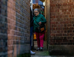 © Licensed to London News Pictures. 02/02/2020. London, UK. Shoppers are lead to safety down an alley way as forensics search the area. Terror attack in Streatham South London as Police shoot dead a knife-wielding suspect in a suicide vest after two people were stabbed. Photo credit: Alex Lentati/LNP