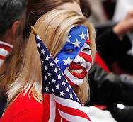 A United States fan cheers at the women's 1000 meter short track speed skating competition at the 2010 Winter Olympics in Vancouver, Canada on February 24, 2010.  (UPI)