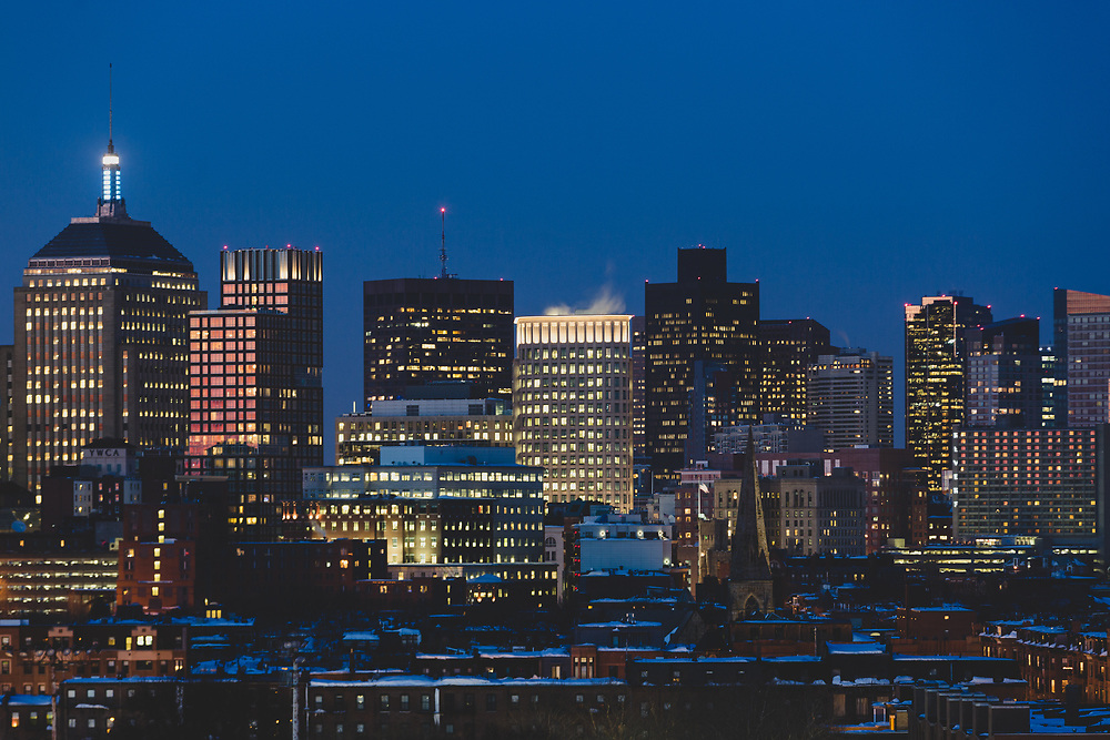 The skyline of Downtown Boston seen from the south on a freezing cold winter evening.